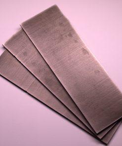 A stack of Nitinol knife blanks
